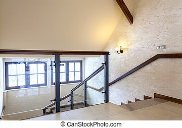 Second floor of modern building, glass banister