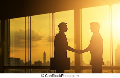 Second hand business hand in concept office silhouettes and successful business partner.