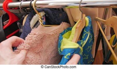 Second hand clothes man hands POV