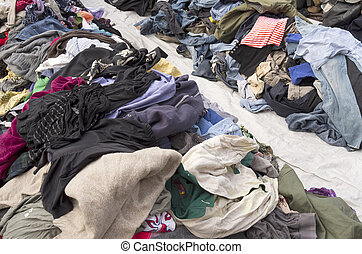 Second hand clothing. - Second hand clothing is displayed on...