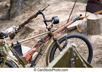 second world war bike with rifle