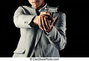 secret-agent guy  holding a gun