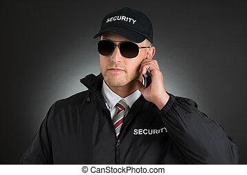 Secret Agent Listening To Earpiece