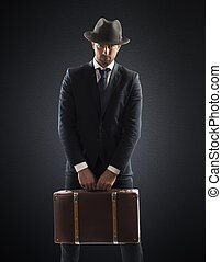 Secret agent - Elegant man with suitcase tie and hat
