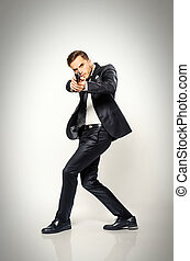 Secret Agent - Secret agent in black suit turning fast and...