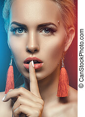 secret. beautiful girl with his finger near the lips