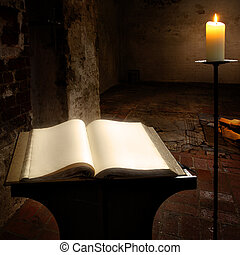 Secret book - Open book with blank pages and candle