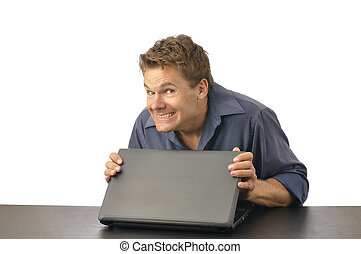 Secret computer content - Man with guilty grin carefully ...