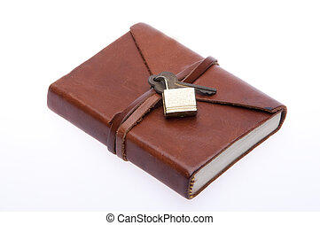 Old leather journal with lock and key. File is isolated in white and includes a clipping path.