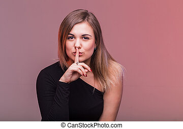 Secret girl. Woman saying hush be quiet with finger on lips gesture