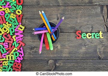 Secret on wooden table