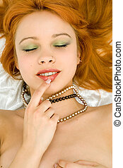 secret smile - redhead girl smiling
