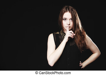 Secret woman. Girl showing hand silence sign - Secret woman ...