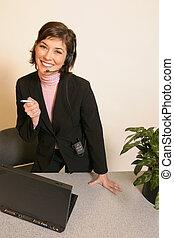 Secretary on the phone using a headset.