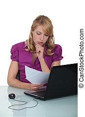 Secretary reviewing paperwork