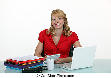 Secretary sat at her desk
