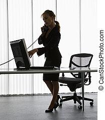 Secretary. - Silhouette of Caucasian businesswoman standing...