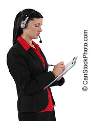 secretary wearing headset and taking notes