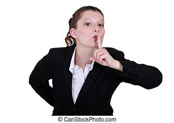 secretary with finger before her mouth