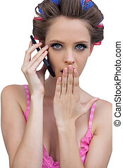 Secretive model wearing hair roller