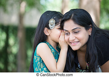 Secrets - Closeup portrait, daughter whispering secrets in...