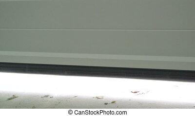 Sectional automatic garage door opening