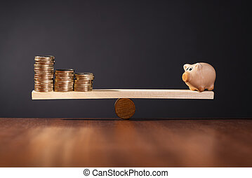 Secure Investment - Seesaw with piggy bank on one side and...
