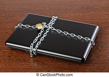 secured laptop on wooden background