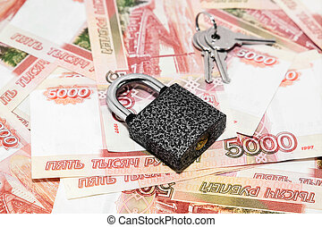 Securing finances. Lock and keys are on the Russian money