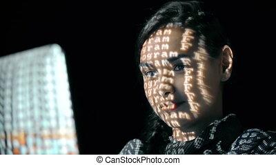 Security Break - Macro shot of female face with binary code...
