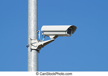 security camera and urban video at pole  blue sky
