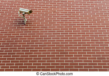 Security Camera CCTV On The Brick Wall