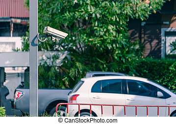 Security camera monitoring outdoor car park.