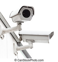 Security cameras mounted on a white wall.