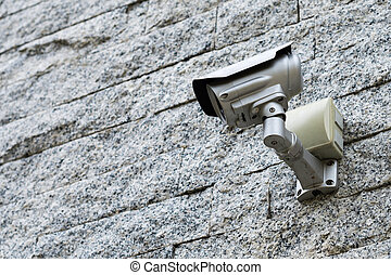 Security Camera on a grey stone wall