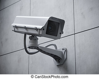 Security camera on the wall of a building.