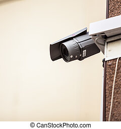 security camera on the wall of a building