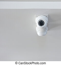 security camera on white wall in the office, cctv in home