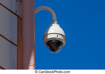 Security camera sphere on the old wall