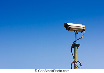 Security camera with a sky background