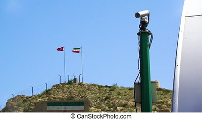 Security Camera With Flags in Background - Handheld,...