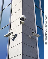 Security cameras - Three security cameras attached on...