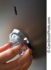 Security code of safe - Close-up of hand searching security...