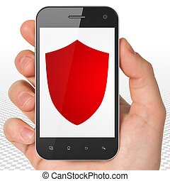 Security concept: Hand Holding Smartphone with Shield on display