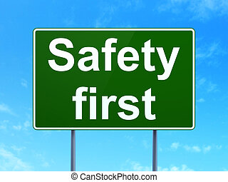 Security concept: Safety First on road sign background