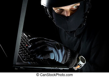 Security concept with man and laptop at night - Security ...