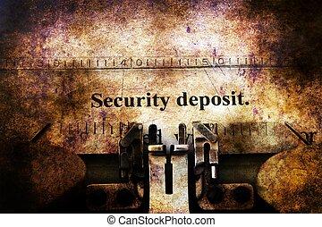 Security deposit text on vintage typewriter