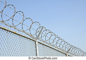 Chain link security fence with razor wire