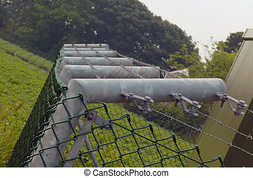 security fence surounding a power generator