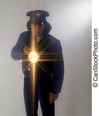 guard with flashlight